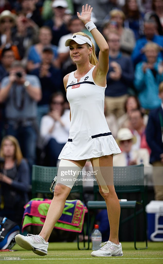 <a gi-track='captionPersonalityLinkClicked' href=/galleries/search?phrase=Agnieszka+Radwanska&family=editorial&specificpeople=579516 ng-click='$event.stopPropagation()'>Agnieszka Radwanska</a> of Poland celebrates victory during the Ladies' Singles quarter-final match against Na Li of China on day eight of the Wimbledon Lawn Tennis Championships at the All England Lawn Tennis and Croquet Club at Wimbledon on July 2, 2013 in London, England.