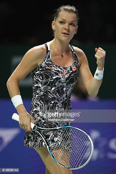 Agnieszka Radwanska of Poland celebrates victory in her singles match against Garbine Muguruza of Spain during day 4 of the BNP Paribas WTA Finals...
