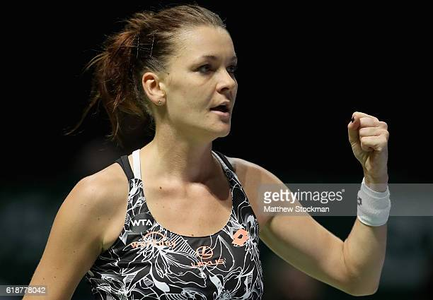 Agnieszka Radwanska of Poland celebrates victory in her singles match against Karolina Pliskova of Czech Republic during day 6 of the BNP Paribas WTA...
