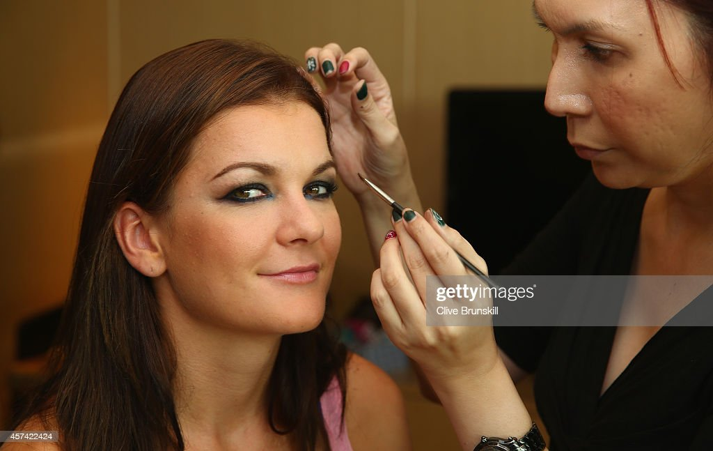 Agnieszka Radwanska of Poland has hair and make up at the Marina Bay Sands hotel before the draw ceremony prior to the start of the BNP Paribas WTA Finals at Singapore Sports Hub on October 18, 2014 in Singapore.