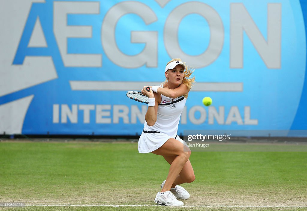 <a gi-track='captionPersonalityLinkClicked' href=/galleries/search?phrase=Agnieszka+Radwanska&family=editorial&specificpeople=579516 ng-click='$event.stopPropagation()'>Agnieszka Radwanska</a> of Poland hits a backhand during her match against Jamie Hampton of USA during day four of the AEGON International tennis tournament at Devonshire Park on June 18, 2013 in Eastbourne, England.