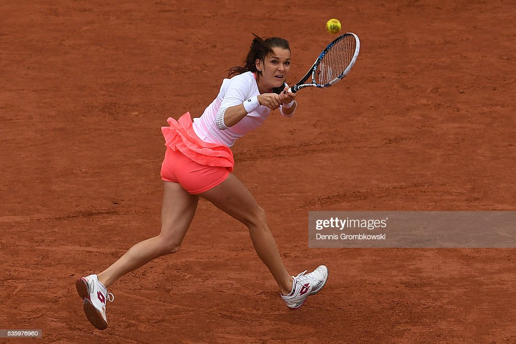 <a gi-track='captionPersonalityLinkClicked' href=/galleries/search?phrase=Agnieszka+Radwanska&family=editorial&specificpeople=579516 ng-click='$event.stopPropagation()'>Agnieszka Radwanska</a> of Poland hits a backhand during the Ladies Singles fourth round match against Tsvetana Pironkova of Bulgaria on day ten of the 2016 French Open at Roland Garros on May 31, 2016 in Paris, France.