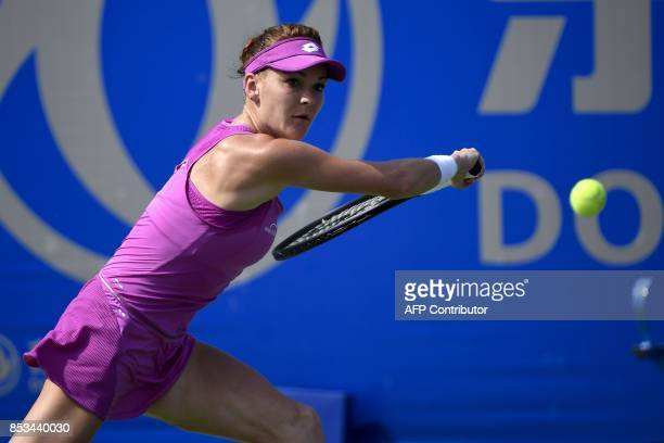 Agnieszka Radwanska of Poland hits a return against Magdalena Rybarikova of Slovakia at the WTA Wuhan Open tennis tournament in Wuhan China's central...
