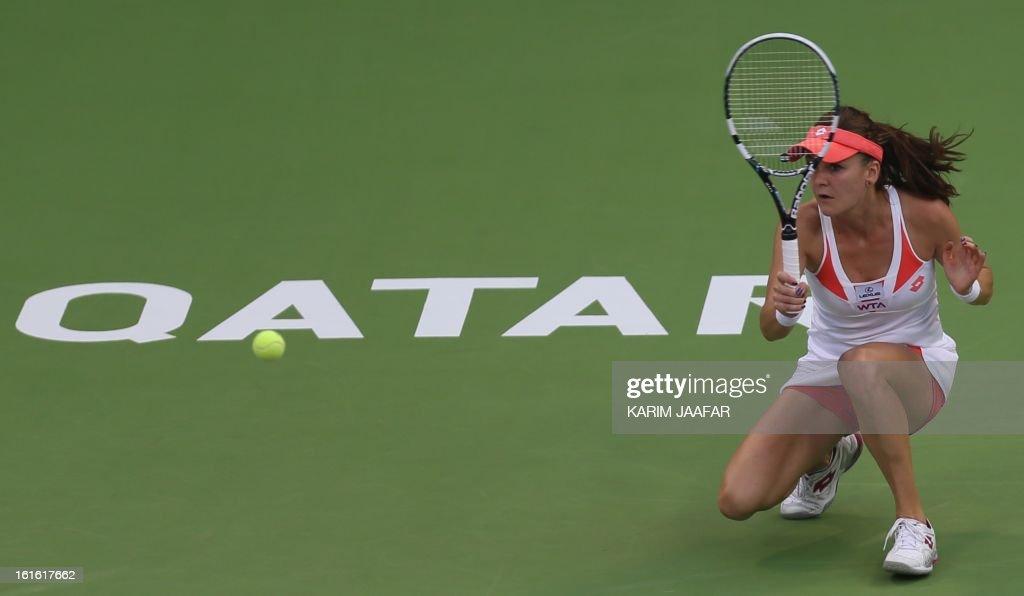 Agnieszka Radwanska of Poland hits a return to Anastasia Rodionova of Australia during their WTA Qatar Open tennis match on February 13, 2013 in the Qatari capital Doha.