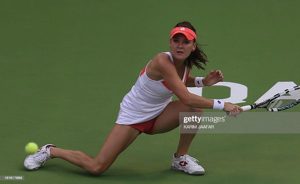 Agnieszka Radwanska of Poland hits a return to Anastasia Rodionova of Australia during their WTA Qatar Open tennis match on February 13, 2013 in the Qatari capital Doha. AFP PHOTO / AL-WATAN DOHA / KARIM JAAFAR == QATAR OUT ==