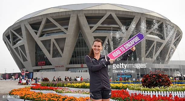 Agnieszka Radwanska of Poland holds a 'Road to Singapore' sign after she secured her qualification for the BNP Paribas WTA Finals in Singapore...