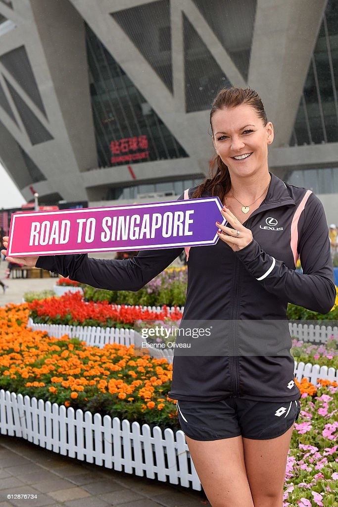 Agnieszka Radwanska of Poland holds a 'Road to Singapore' sign after she secured her qualification for the BNP Paribas WTA Finals in Singapore presented by SC Global, on day five of the 2016 China Open at the China National Tennis Centre on October 5, 2016 in Beijing, China.