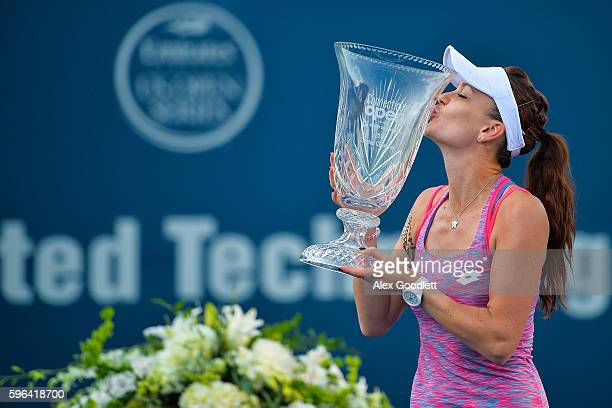 Agnieszka Radwanska of Poland holds her trophy after defeating Elina Svitolina of Ukraine in the women's singles final on day 7 of the Connecticut...