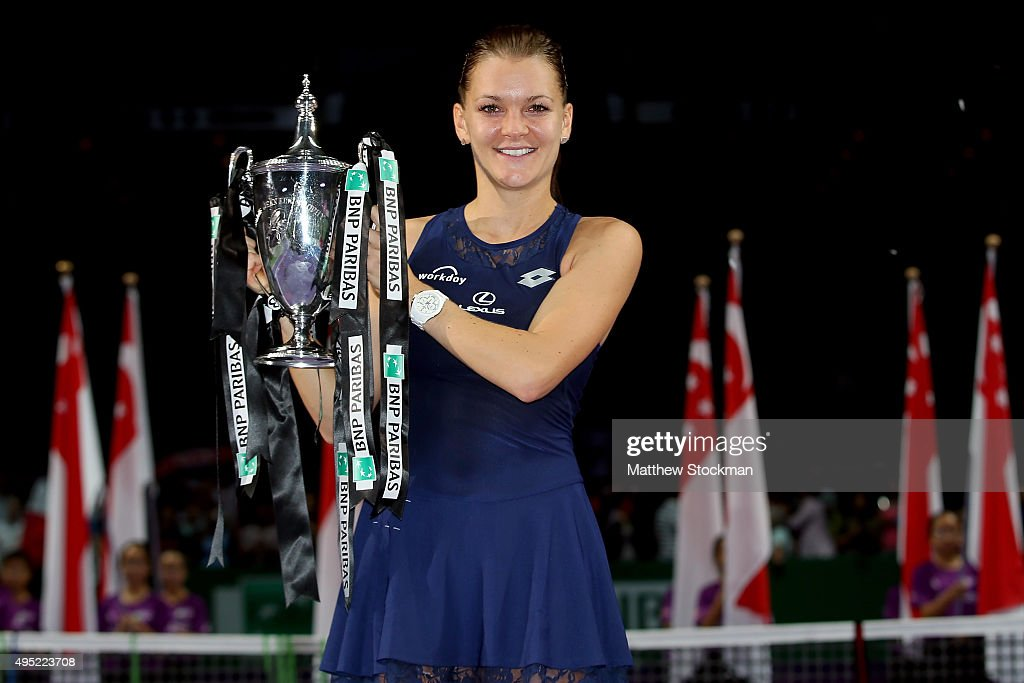 <a gi-track='captionPersonalityLinkClicked' href=/galleries/search?phrase=Agnieszka+Radwanska&family=editorial&specificpeople=579516 ng-click='$event.stopPropagation()'>Agnieszka Radwanska</a> of Poland holds the Billie Jean King Trophy after defeating Petra Kvitova of Czech Republic in the final match during the BNP Paribas WTA Finals at Singapore Sports Hub on November 1, 2015 in Singapore.