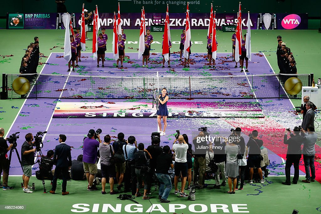 Agnieszka Radwanska of Poland holds the Billie Jean King Trophy after defeating Petra Kvitova of Czech Republic in the final match during the BNP Paribas WTA Finals at Singapore Sports Hub on November 1, 2015 in Singapore.