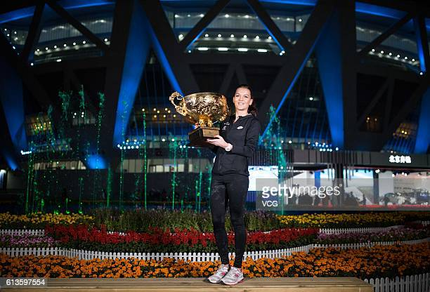 Agnieszka Radwanska of Poland holds the winners trophy after winning the Women's Singles final against Johanna Konta of Great Britain on day nine of...
