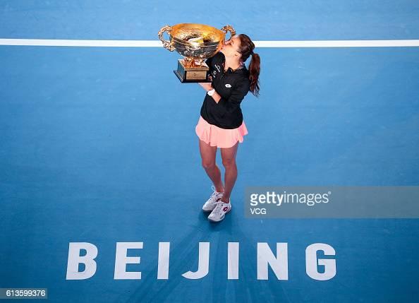 Agnieszka Radwanska of Poland holds the winners trophy after winning the Women's Singles final against Johanna Konta of Great Britain on day nine of...