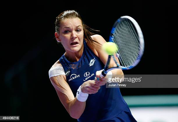 Agnieszka Radwanska of Poland in action against Flavia Pennetta of Italy in a round robin match during the BNP Paribas WTA Finals at Singapore Sports...