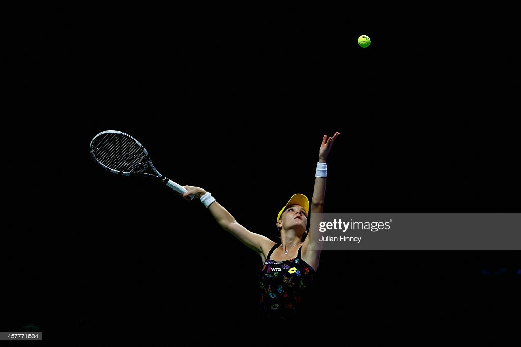 Agnieszka Radwanska of Poland in action against Maria Sharapova of Russia during day five of the BNP Paribas WTA Finals tennis at the Singapore Sports Hub on October 24, 2014 in Singapore.