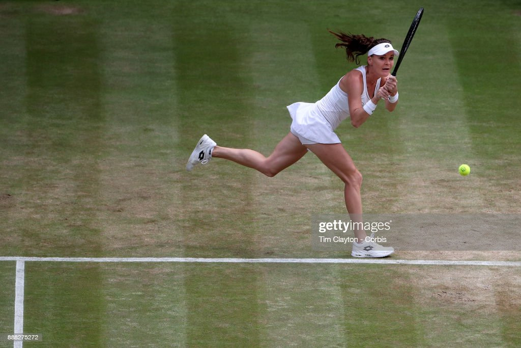 Agnieszka Radwanska of Poland in action against Times Bacsinszky of Switzerland on Centre Court during the Wimbledon Lawn Tennis Championships at the All England Lawn Tennis and Croquet Club at Wimbledon on July 8, 2017 in London, England.