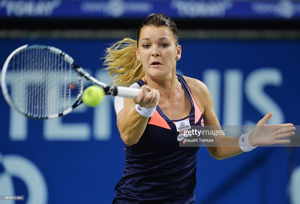 <a gi-track='captionPersonalityLinkClicked' href=/galleries/search?phrase=Agnieszka+Radwanska&family=editorial&specificpeople=579516 ng-click='$event.stopPropagation()'>Agnieszka Radwanska</a> of Poland in action during her women's singles quarter final match against Angelique Kerber of Germany during day five of the Toray Pan Pacific Open at Ariake Colosseum on September 26, 2013 in Tokyo, Japan.