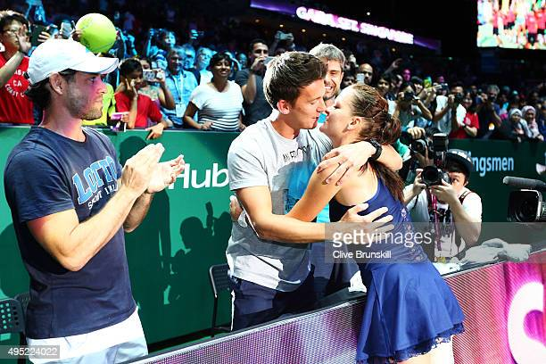 Agnieszka Radwanska of Poland is congratulated by friends and family after defeating Petra Kvitova of Czech Republic in the final match during the...