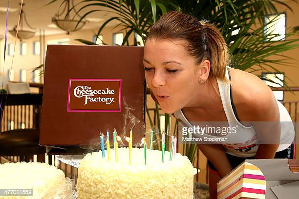Agnieszka Radwanska of Poland is presented a cake in celebration of her birthday during the BNP Parabas Open at the Indian Wells Tennis Garden on...