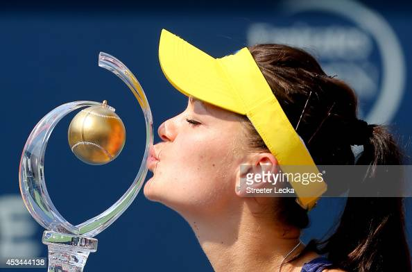 Agnieszka Radwanska of Poland kisses the trophy after defeating Venus Williams of the USA during the women's finals match at Uniprix Stadium on...