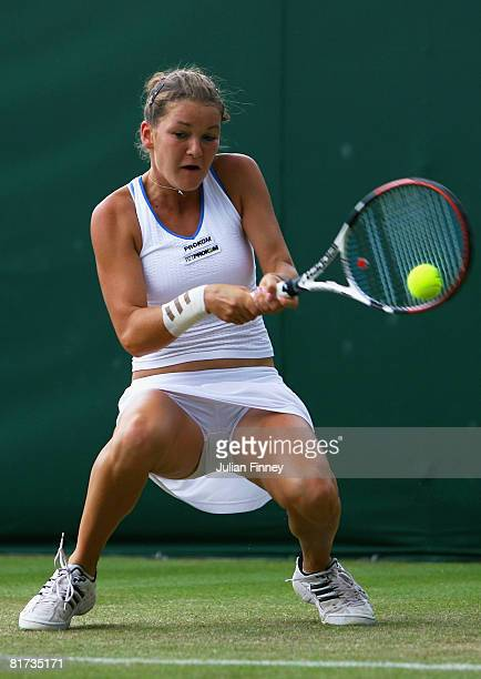Agnieszka Radwanska of Poland plays a backhand during the round three women's singles match against Anastasia Pavlyuchenkova of Russia on day five of...