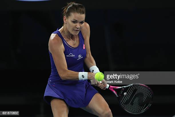 Agnieszka Radwanska of Poland plays a backhand in her first round match against Tsvetana Pironkova of Bulgaria on day two of the 2017 Australian Open...