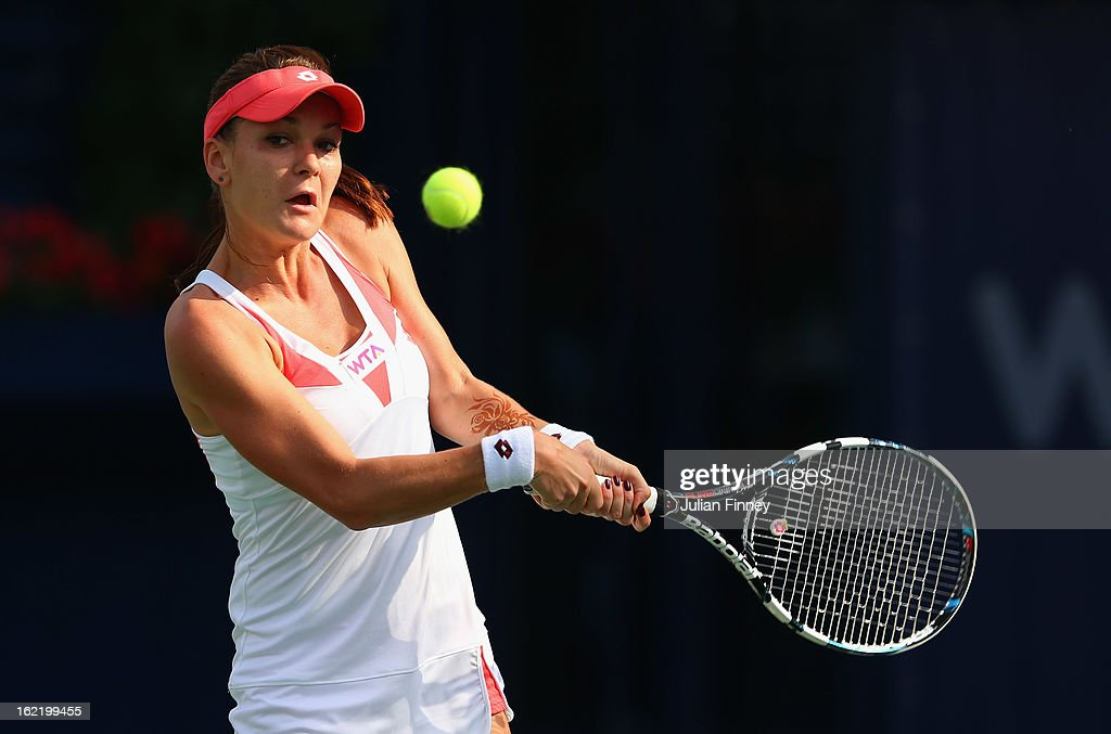 Agnieszka Radwanska of Poland plays a backhand in her match against Yulia Putintseva of Kazakhstan during day three of the WTA Dubai Duty Free Tennis Championship on February 20, 2013 in Dubai, United Arab Emirates.