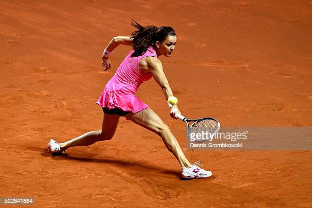 Agnieszka Radwanska of Poland plays a backhand in her match against Andrea Petkovic of Germany during Day 4 of the Porsche Tennis Grand Prix at...
