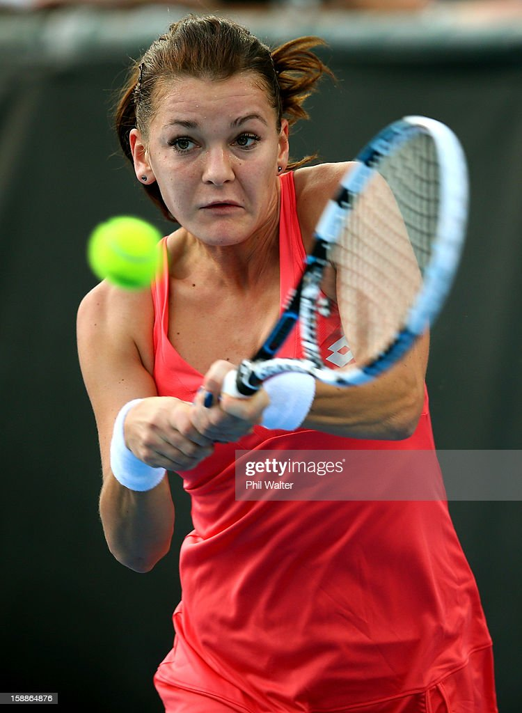 <a gi-track='captionPersonalityLinkClicked' href=/galleries/search?phrase=Agnieszka+Radwanska&family=editorial&specificpeople=579516 ng-click='$event.stopPropagation()'>Agnieszka Radwanska</a> of Poland plays a backhand in her second round match against Simona Halep of Romania during day three of the 2013 ASB Classic on January 2, 2013 in Auckland, New Zealand.
