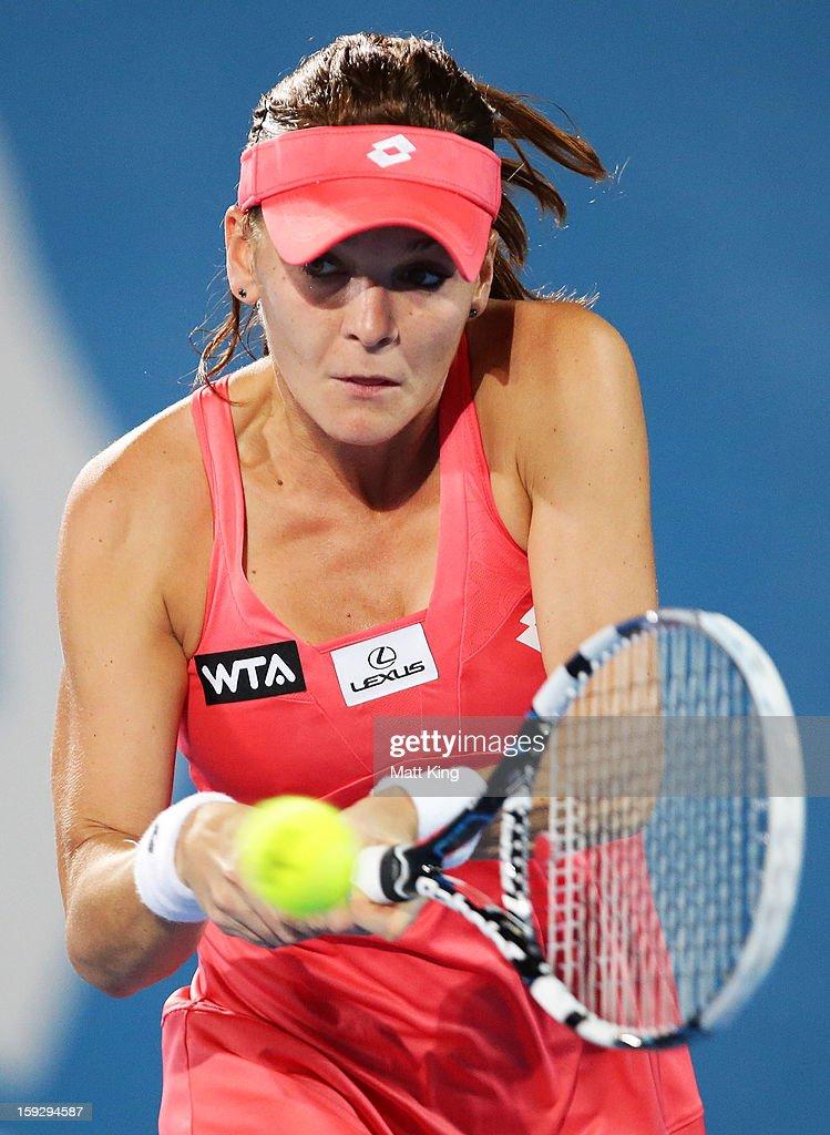 Agnieszka Radwanska of Poland plays a backhand in the women's final match against Dominika Cibulkova of Slovakia during day six of the Sydney International at Sydney Olympic Park Tennis Centre on January 11, 2013 in Sydney, Australia.