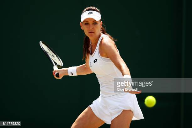 Agnieszka Radwanska of Poland plays a forehand during the Ladies Singles fourth round match against Svetlana Kuznetsova of Russia on day seven of the...