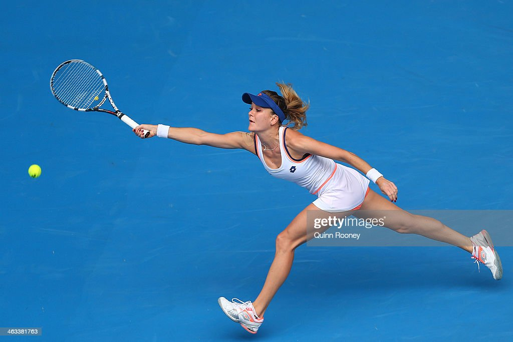 Agnieszka Radwanska of Poland plays a forehand in her third round match against Anastasia Pavlyuchenkova of Russia during day six of the 2014 Australian Open at Melbourne Park on January 18, 2014 in Melbourne, Australia.
