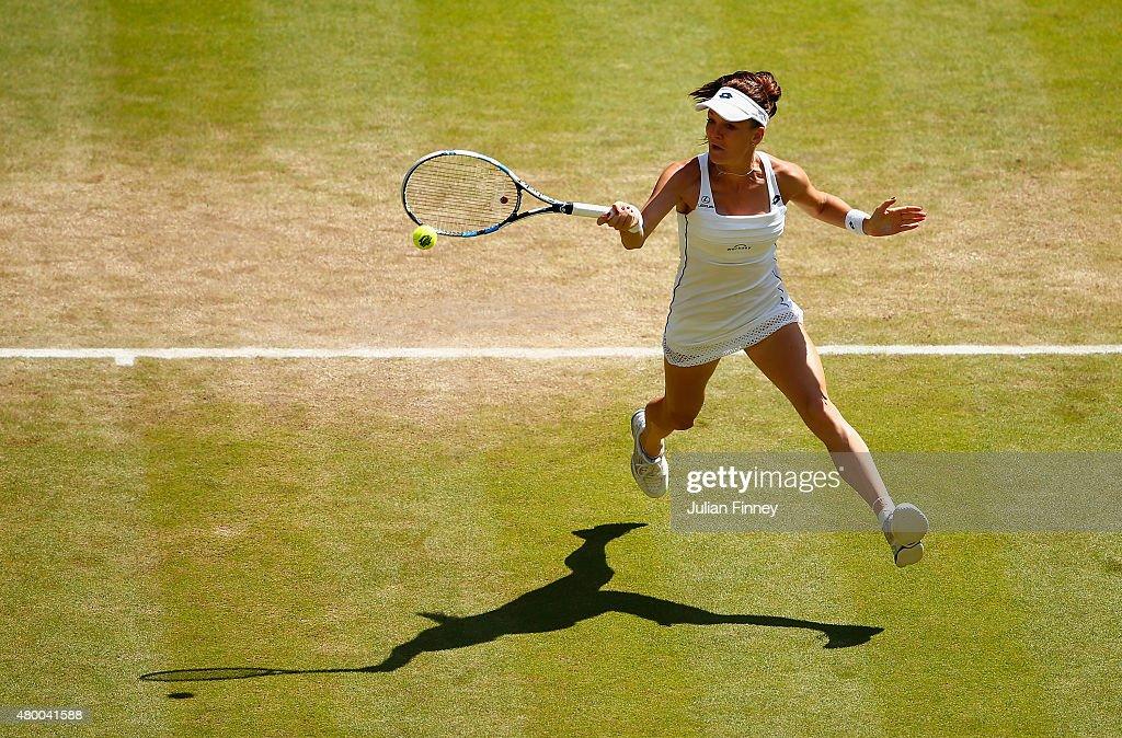 Agnieszka Radwanska of Poland plays a forehand in the Ladies Singles Semi Final match against Garbine Muguruza of Spain during day ten of the...