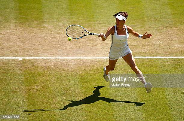 Agnieszka Radwanska of Poland plays a forehand in the Ladies Singles Semi Final match against Garbine Muguruza of Spain during day ten of the...