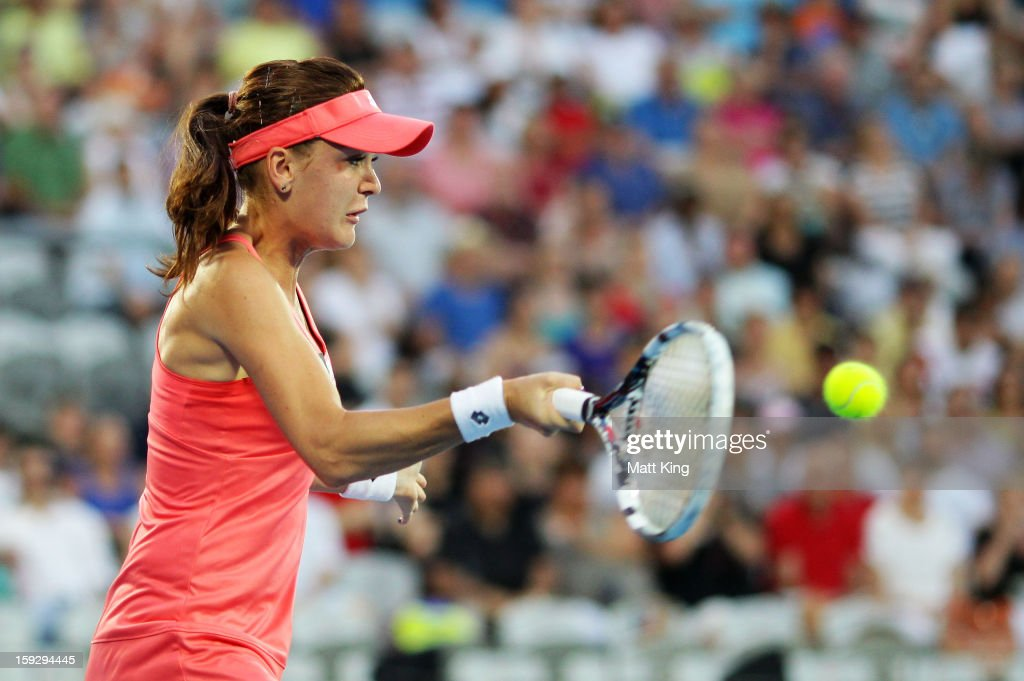 <a gi-track='captionPersonalityLinkClicked' href=/galleries/search?phrase=Agnieszka+Radwanska&family=editorial&specificpeople=579516 ng-click='$event.stopPropagation()'>Agnieszka Radwanska</a> of Poland plays a forehand in the women's final match against Dominika Cibulkova of Slovakia during day six of the Sydney International at Sydney Olympic Park Tennis Centre on January 11, 2013 in Sydney, Australia.