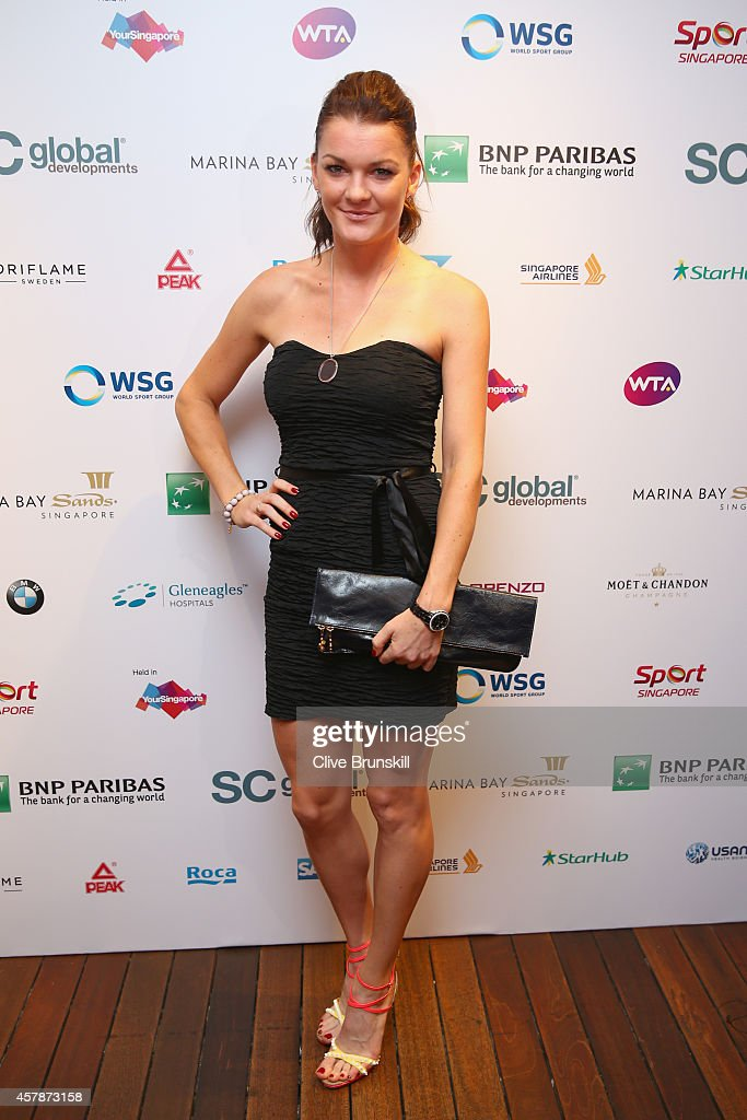 <a gi-track='captionPersonalityLinkClicked' href=/galleries/search?phrase=Agnieszka+Radwanska&family=editorial&specificpeople=579516 ng-click='$event.stopPropagation()'>Agnieszka Radwanska</a> of Poland poses for a photograph at the WTA Year End Gala Party at the Marina Bay Sands Hotel during the BNP Paribas WTA Finals at Singapore Sports Hub on October 25, 2014 in Singapore.