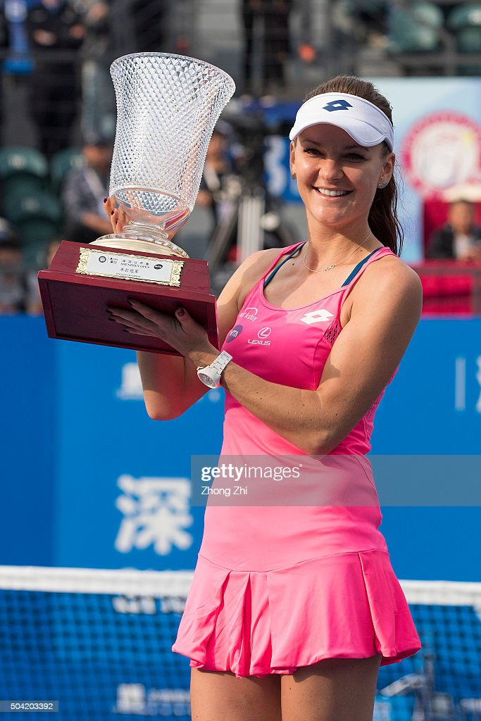 Agnieszka Radwanska of Poland poses with her trophy after winning the singles final match against Alison Riske of the USA during Day 7 of 2016 WTA Shenzhen Open at Longgang Sports Center on January 9, 2016 in Shenzhen, China.