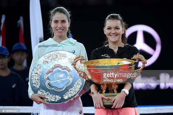 Agnieszka Radwanska of Poland poses with runnerup Johanna Konta of Britain during the awards ceremony after the women's singles final of the China...