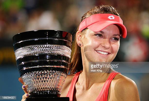 Agnieszka Radwanska of Poland poses with the champions trophy after winning the women's final match against Dominika Cibulkova of Slovaki during day...