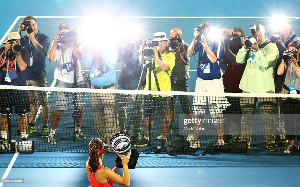 <a gi-track='captionPersonalityLinkClicked' href=/galleries/search?phrase=Agnieszka+Radwanska&family=editorial&specificpeople=579516 ng-click='$event.stopPropagation()'>Agnieszka Radwanska</a> of Poland poses with the winners trophy after winning the final against Dominika Cibulkova of Slovakia during day six of the Sydney International at Sydney Olympic Park Tennis Centre on January 11, 2013 in Sydney, Australia.