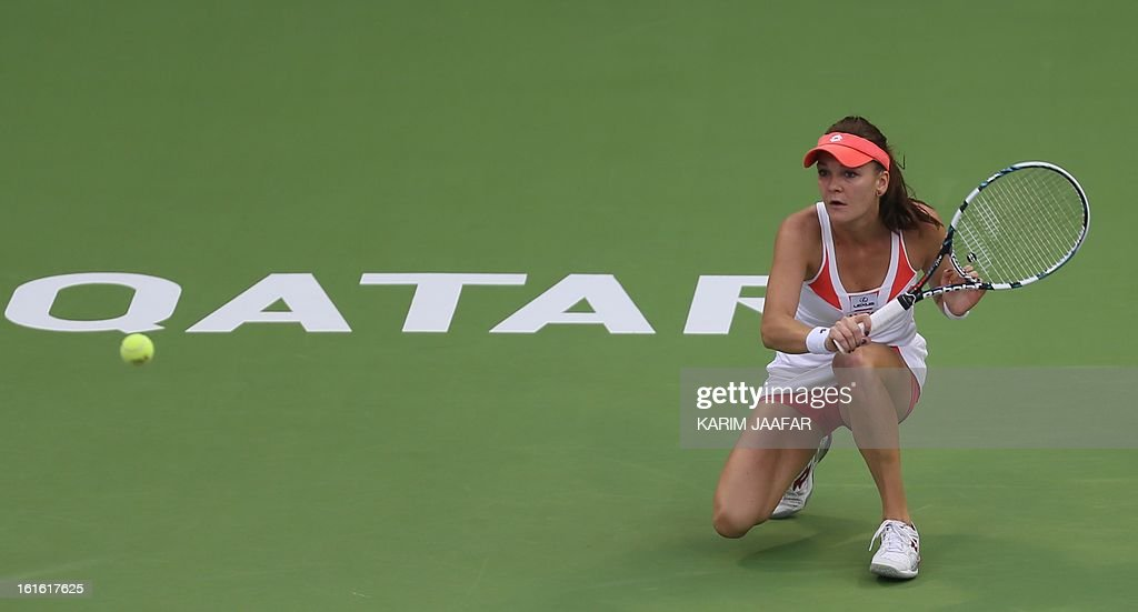 Agnieszka Radwanska of Poland prepares to hit a return to Anastasia Rodionova of Australia during their WTA Qatar Open tennis match on February 13, 2013 in the Qatari capital Doha. AFP PHOTO / AL-WATAN DOHA / KARIM JAAFAR == QATAR OUT ==