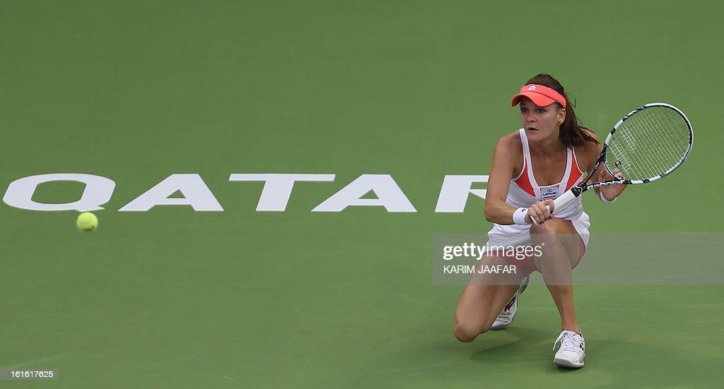 Agnieszka Radwanska of Poland prepares to hit a return to Anastasia Rodionova of Australia during their WTA Qatar Open tennis match on February 13, 2013 in the Qatari capital Doha.