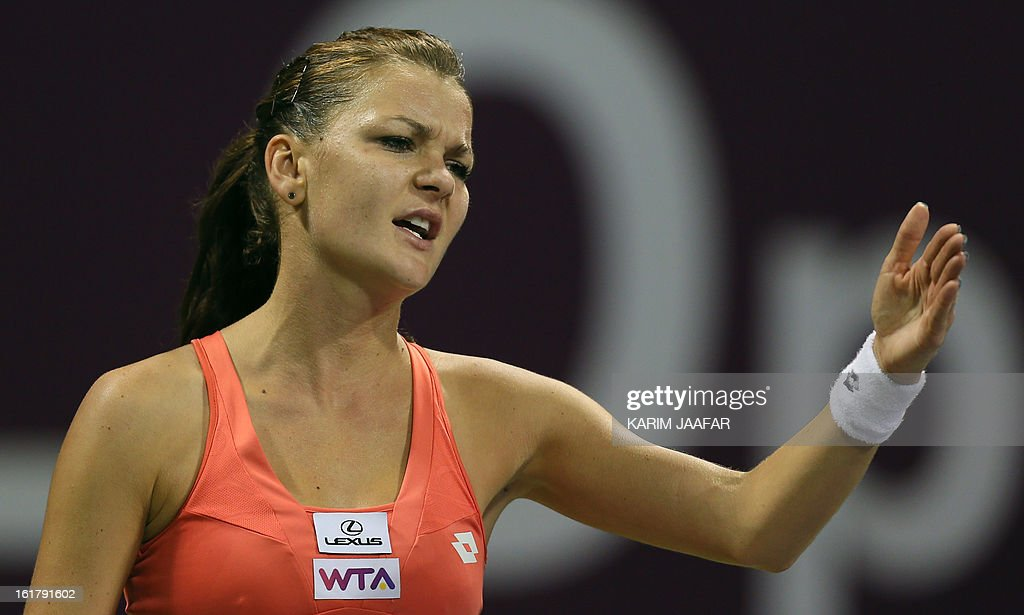 Agnieszka Radwanska of Poland reacts against Belarus Victoria Azarenka during their WTA Qatar Open semi-final tennis match on February 16, 2013 in the Qatari capital, Doha. Azarenka won 6-3, 6-3.