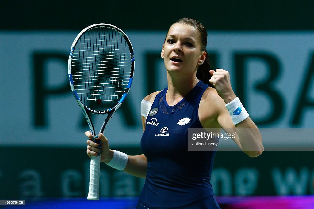 <a gi-track='captionPersonalityLinkClicked' href=/galleries/search?phrase=Agnieszka+Radwanska&family=editorial&specificpeople=579516 ng-click='$event.stopPropagation()'>Agnieszka Radwanska</a> of Poland reacts during her semi-final match against Garbine Muguruza of Spain during BNP Paribas WTA Finals at Singapore Sports Hub on October 31, 2015 in Singapore.