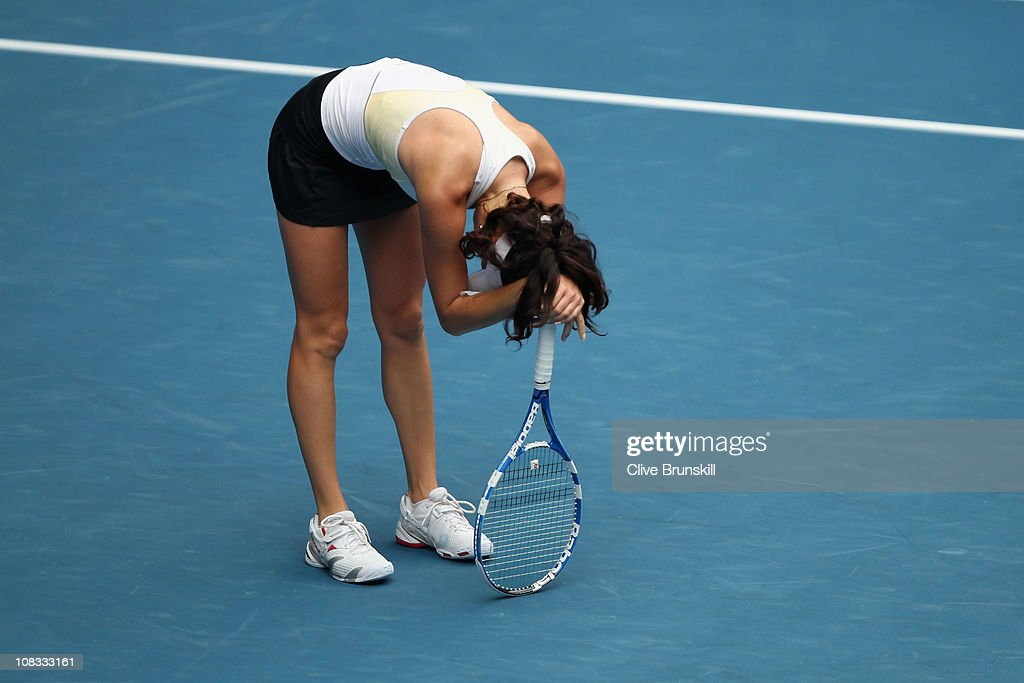 <a gi-track='captionPersonalityLinkClicked' href=/galleries/search?phrase=Agnieszka+Radwanska&family=editorial&specificpeople=579516 ng-click='$event.stopPropagation()'>Agnieszka Radwanska</a> of Poland reacts in her quarterfinal match against Kim Clijsters of Belgium during day ten of the 2011 Australian Open at Melbourne Park on January 26, 2011 in Melbourne, Australia.
