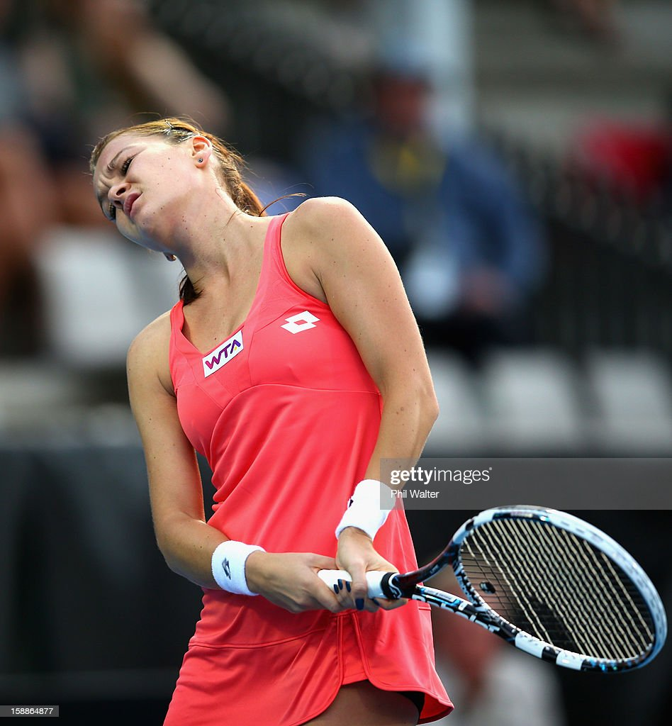 <a gi-track='captionPersonalityLinkClicked' href=/galleries/search?phrase=Agnieszka+Radwanska&family=editorial&specificpeople=579516 ng-click='$event.stopPropagation()'>Agnieszka Radwanska</a> of Poland reacts in her second round match against Simona Halep of Romania during day three of the 2013 ASB Classic on January 2, 2013 in Auckland, New Zealand.
