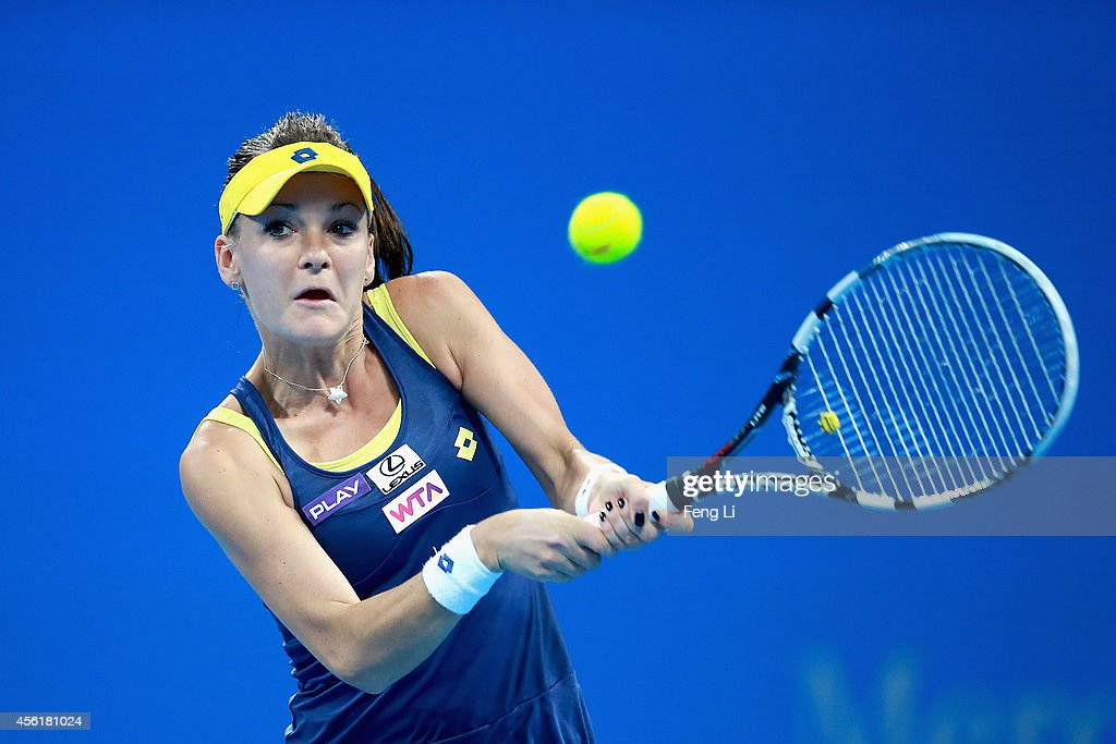 Agnieszka Radwanska of Poland returns a shot against Coco Vandeweghe of the United States during day one of the China Open at the China National...