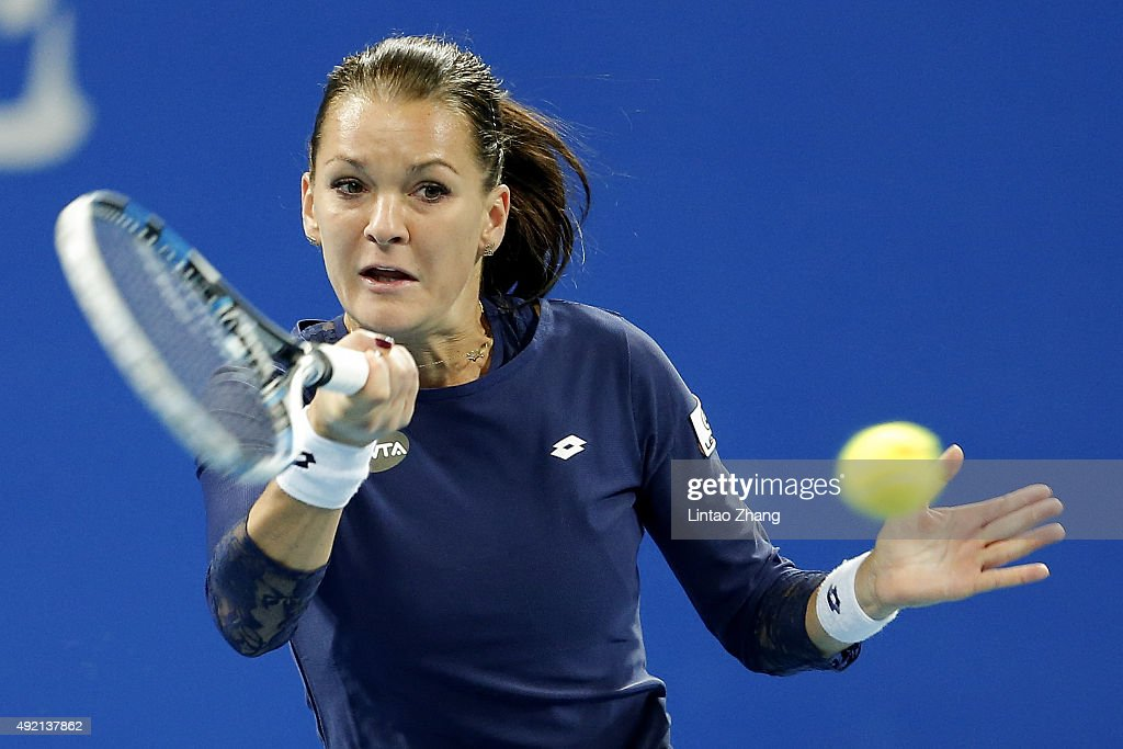 <a gi-track='captionPersonalityLinkClicked' href=/galleries/search?phrase=Agnieszka+Radwanska&family=editorial&specificpeople=579516 ng-click='$event.stopPropagation()'>Agnieszka Radwanska</a> of Poland returns a shot against Garbine Muguruza of Spain during their Women's singles semi-finals match on day 8 of the 2015 China Open at the China National Tennis Centre on October 10, 2015 in Beijing, China.