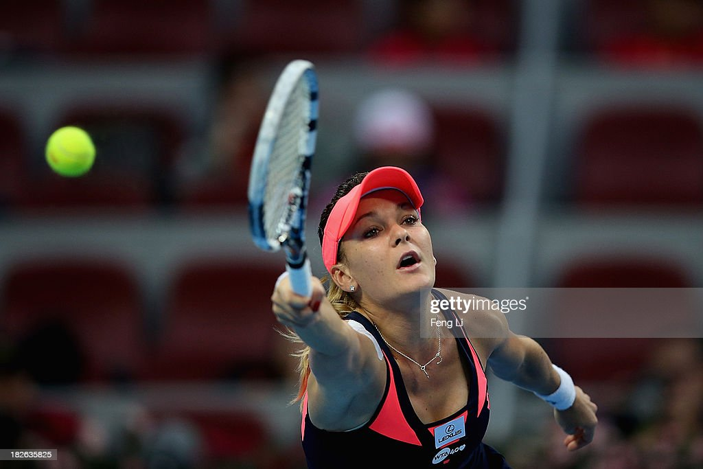 <a gi-track='captionPersonalityLinkClicked' href=/galleries/search?phrase=Agnieszka+Radwanska&family=editorial&specificpeople=579516 ng-click='$event.stopPropagation()'>Agnieszka Radwanska</a> of Poland returns a shot during her women's singles match against Madison Keys of United States on day five of the 2013 China Open at the National Tennis Center on October 2, 2013 in Beijing, China.
