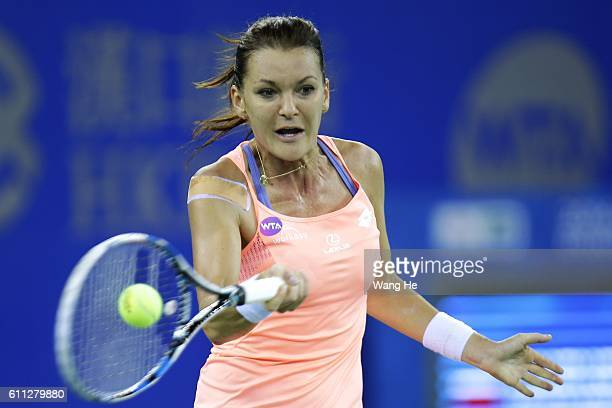 Agnieszka Radwanska of Poland returns a shot during the match against Svetlana Kuznetsova of Russia on Day 5 of the 2016 Dongfeng Motor Wuhan Open at...