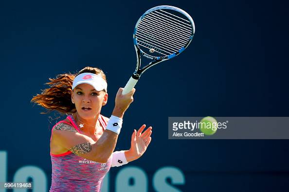 Agnieszka Radwanska of Poland returns a shot to Elina Svitolina of Ukraine during the women's singles final on day 7 of the Connecticut Open at the...